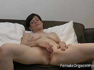 Curly ebony MILF called Daniskas finger thrusts her pussy to orgasm