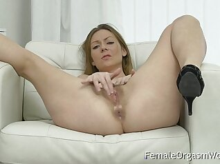 Brunette MILF with a hairy pussy has squirting orgasm