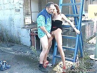 Busty brunette milf eats her lovers balls outdoors